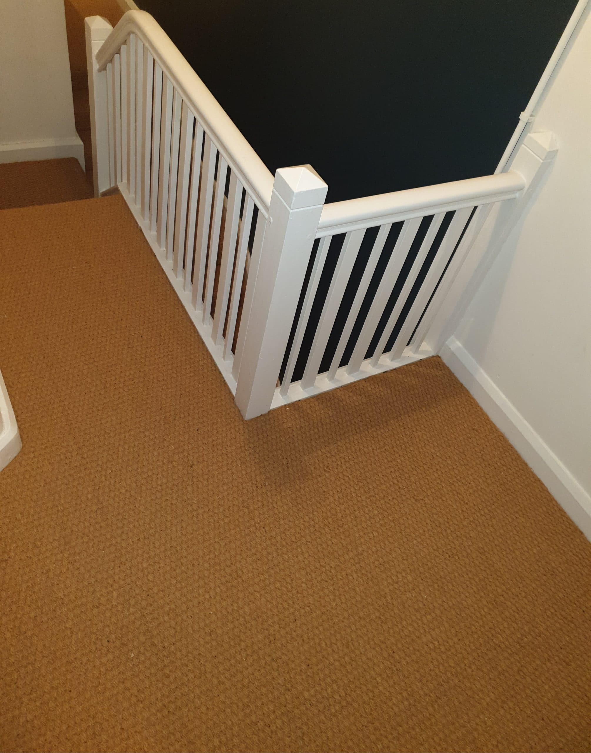 Buying cost of natural stair landing carpet Cheshire